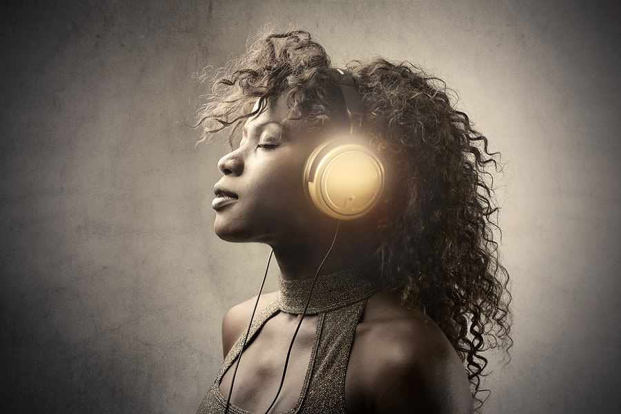 bigstock_young_black_woman_listen_music_12162356