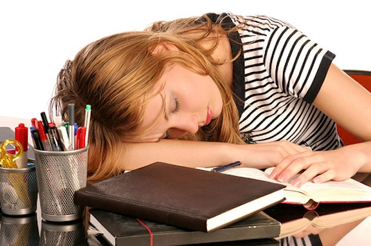 Girl falls asleep on top of homework