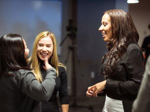 women-networking-talking-laughing