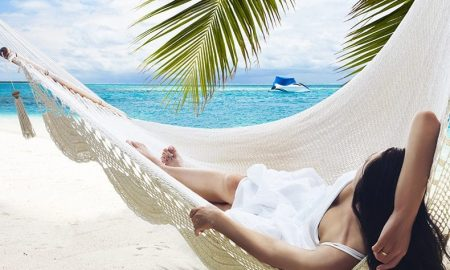 Woman laying in hammock earning passive income
