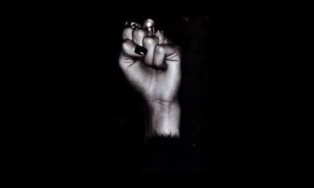 Woman's fist nd Black Power Symbol