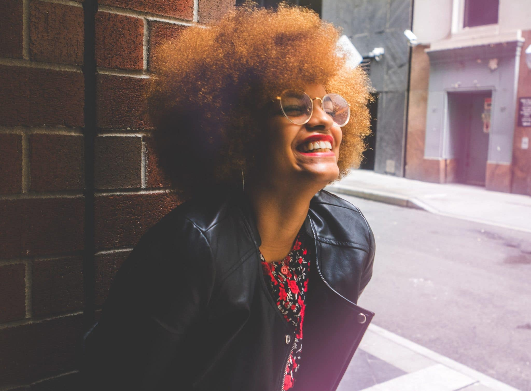 black woman with afro and leather jacket
