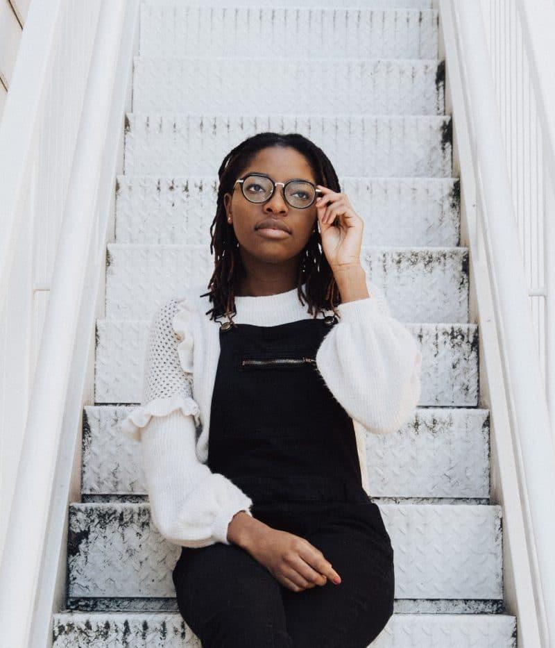black woman wearing glasses