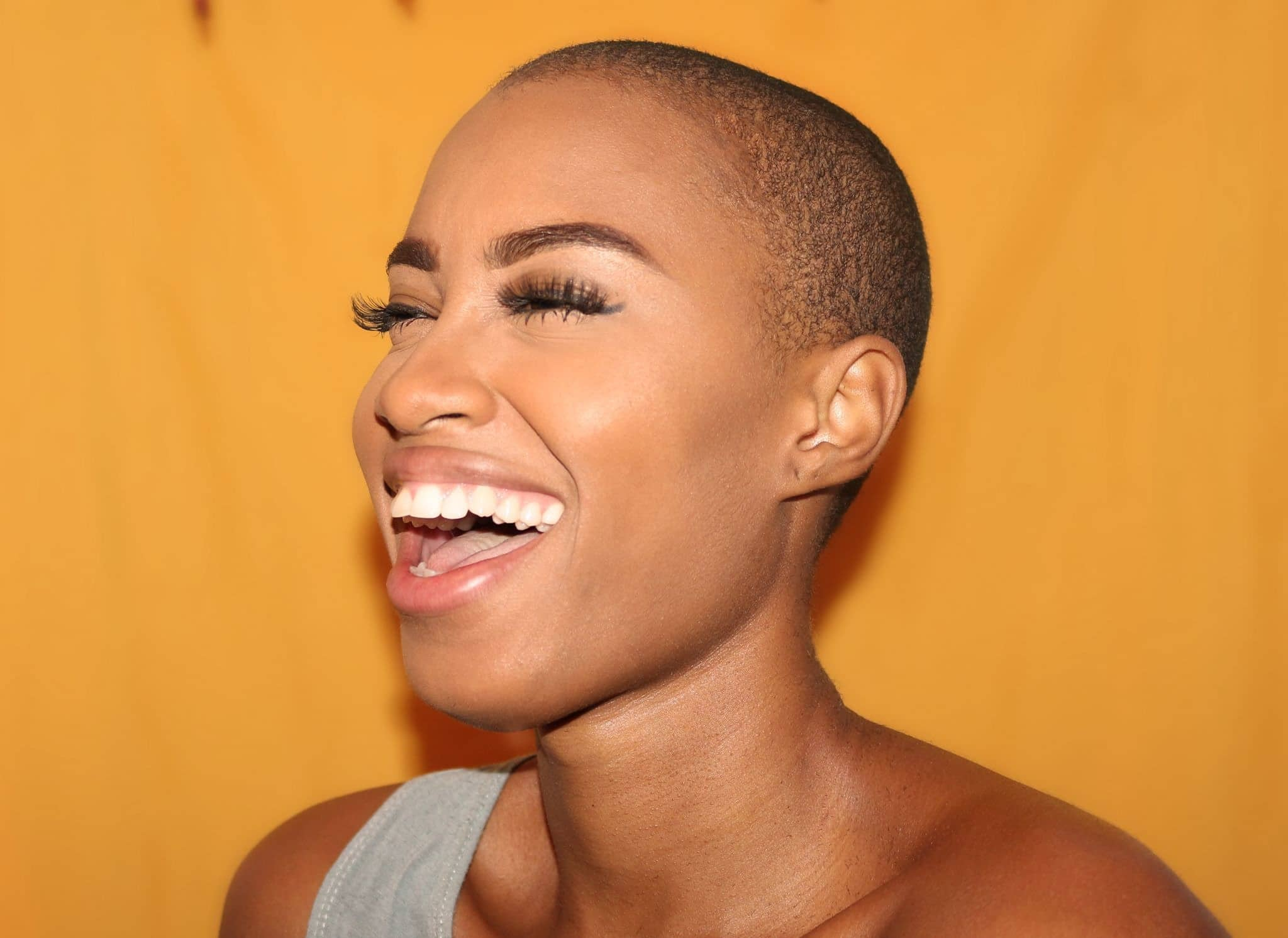 black woman smiling and laughing