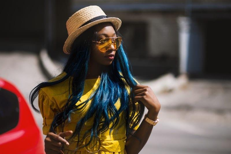 black woman wearing straw hat