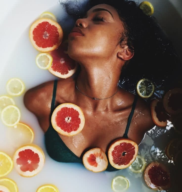 black woman in bathtub with flowers