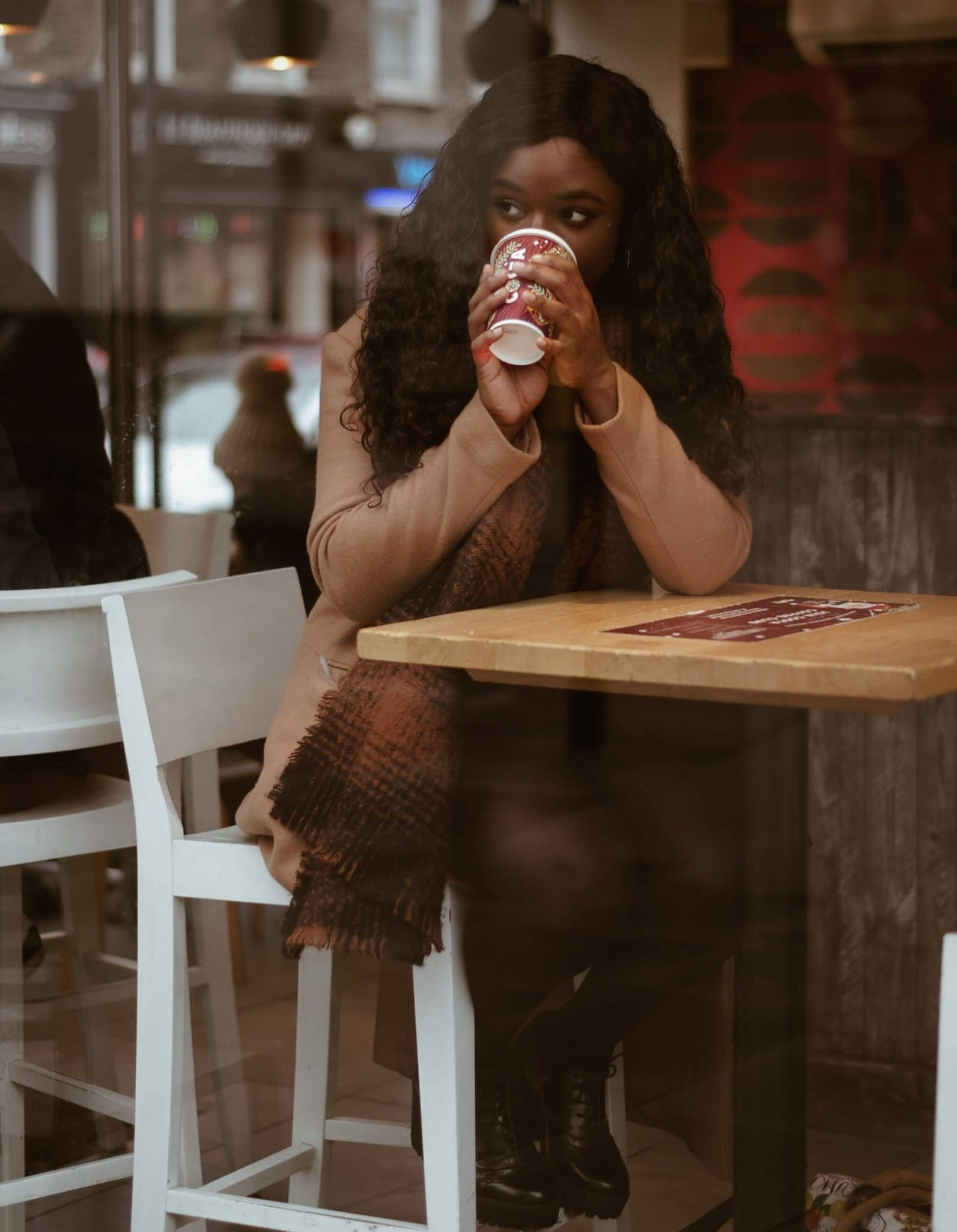 black woman at coffee shop