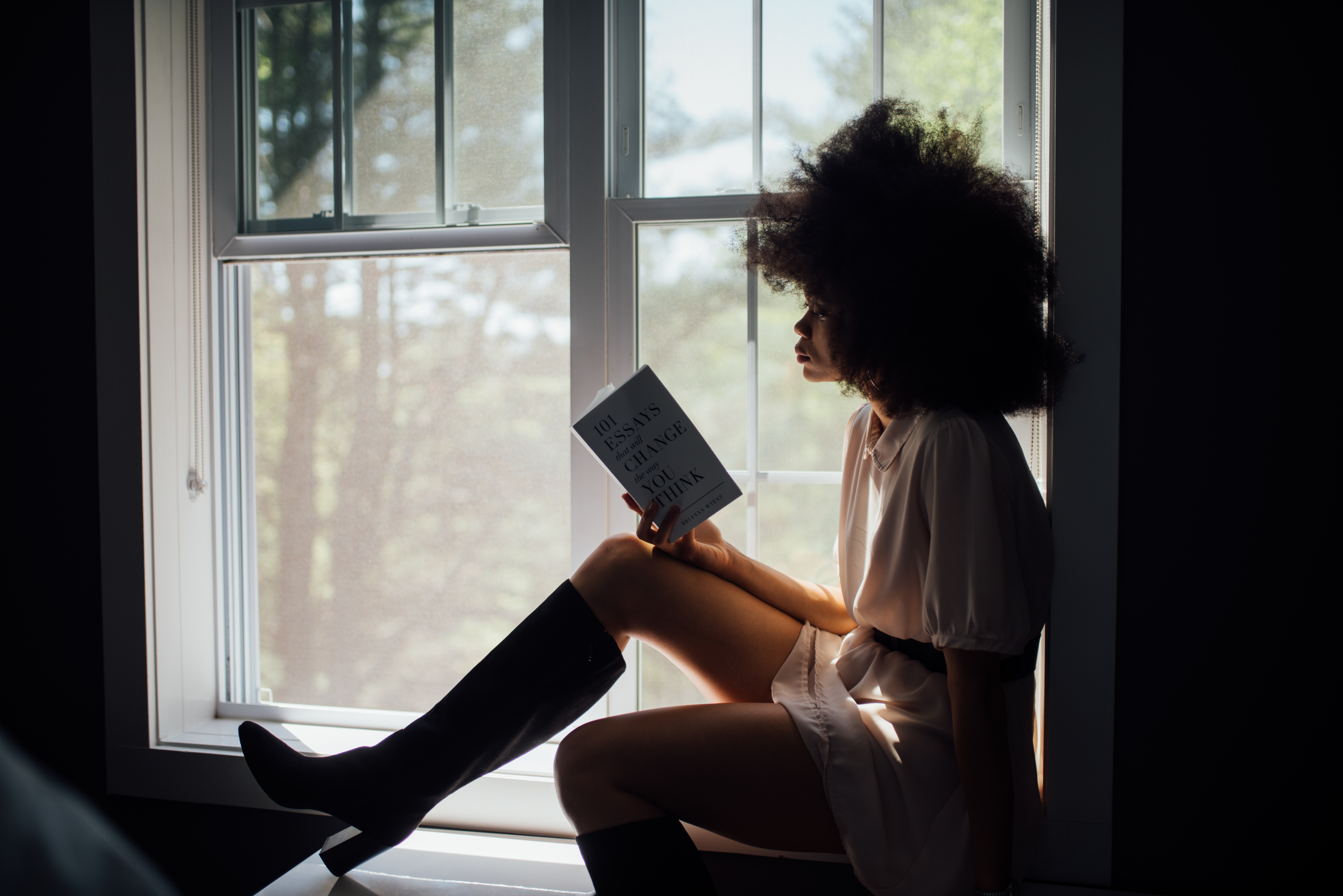 black woman reading a book